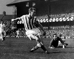 In their playing days - Clough (for Sunderland) scores while Revie (Leeds) looks on in the background